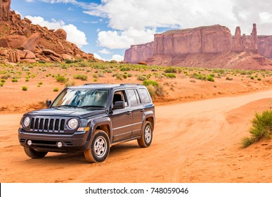 MONUMENT VALLEY, UTAH, USA - MAY 25, 2015 - Offroading through the Monument Valley. four-wheel drive off-road and sport utility vehicle (SUV) on May 25, 2015