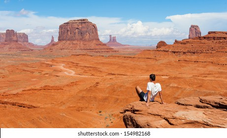 MONUMENT VALLEY, UTAH, USA, SEPTEMBER 26: Unidentified person looks at Monument Valley on September 26, 2012 in Utah. Monument Valley is characterized by a cluster of vast sandstone buttes