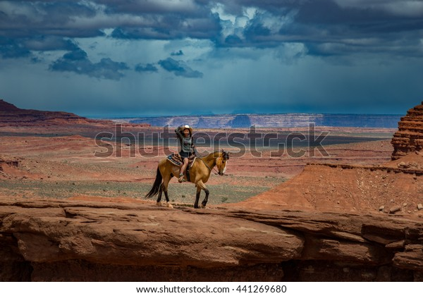 Monument Valley Young Woman Horseback Riding at John's Ford Point