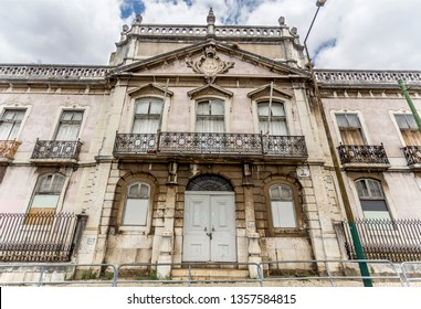 Monumental facade of the derelict Palace of Condes da Ribeira Grande, built in the early years of the 18th century in Alcantara, Lisbon, Portugal