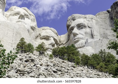 Monumental sculptures of U.S. Presidents Thomas Jefferson, Theodore Roosevelt, and Abraham Lincoln carved into granite at Mount Rushmore National Memorial in the Black Hills of South Dakota, USA