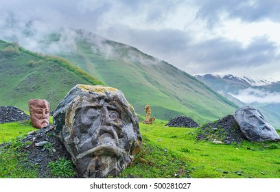 The monumental stone heads of the famous poets and writers in misty gorge of Sno, Georgia.