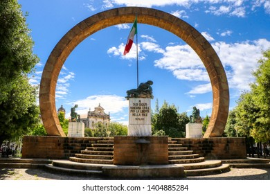 """Monuments to the Fallen in Piazza Vittorio Emanuel. On the tombstone is written """"To his fallen Manduria, civilian for freedom in peace"""". Manduria, Puglia, Italy"""