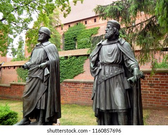 Monuments of Great Masters in the courtyard of the Malbork Castle