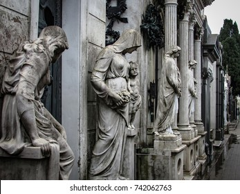 Monuments at Recoleta Cemetery, a public cemetery in Buenos Aires, Argentina. Picture taken during a rainy day.
