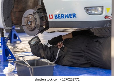 MONZA, ITALY - 18 NOVEMBER 2018: a mechanic working during Vedovati corse on the famous Monza track.