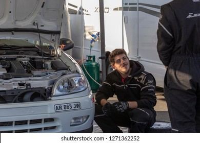 MONZA, ITALY - 18 NOVEMBER 2018: mechanics during cars check-up in between races at Vedovati corse on the famous Monza track.