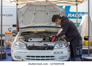 MONZA, ITALY - 18 NOVEMBER 2018: a technician making check up of a car in between races during Vedovati corse