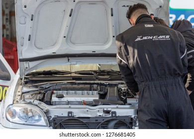 MONZA, ITALY - 18 NOVEMBER 2018: mechanic making checkup of a car during Vedovati corse