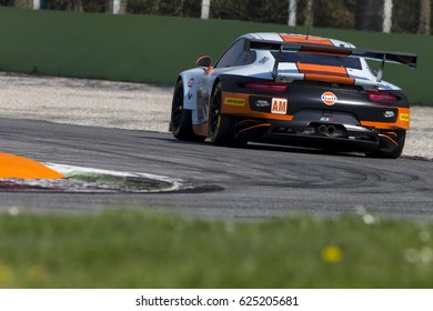 Monza, Italy - April 01, 2017: Porsche 911 RSR of Gulf Racing UK Team, driven by M. Wainwright and B. Barker and N. Foster during the FIA World Endurance Championship  in Autodromo di Monza Circuit.