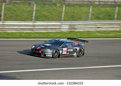 MONZA, ITALY - APRIL 27: Aston Martin DBR9 GT1 driven by Peter Dumbreck, Ralf Kelleners and Alexei Vasilievr racing in the 1000km of Monza. April 27, 2008 in Monza, Italy