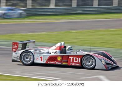 MONZA, ITALY - APRIL 27: Audi R10 TDI LMP1 driven by Allan McNish and Rinaldo Capello racing in the 1000km of Monza. April 27, 2008 in Monza, Italy