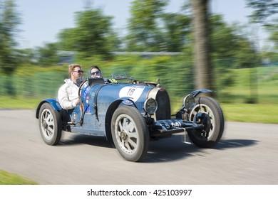 MONZA, ITALY - MAY 22, 2016: Classic car, drivers on BUGATTI T35A (1925) runs in Mille Miglia, classic italian endurance car race (1927-1957)