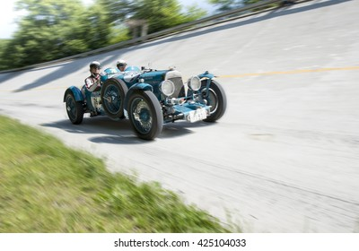 MONZA, ITALY - MAY 22, 2016: Classic car, drivers on ASTON MARTIN LE MANS (1931) runs in Mille Miglia, classic italian endurance car race (1927-1957)