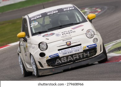 Monza, Italy - October 25, 2014: Fiat Abarth 695 of  V-Action Team, driven by Pajuranta Jusso in action during the Abarth Italia & Europa Trophy - Race in Autodromo Nazionale di Monza Circuit