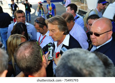 MONZA, ITALY - SEPTEMBER 11 : Chairman of Ferrari, Luca di Montezemolo is giving an interview during the Formula One 2010 at Monza circuit. September 11, 2010 in Monza, Italy