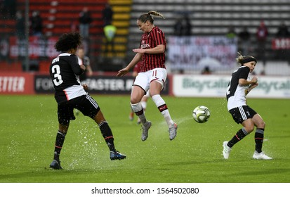 MONZA, ITALY-NOVEMBER 17, 2019: female soccer players action, on a wet green soccer field, during the italian soccer match AC Milan vs Juventus FC, in Monza.