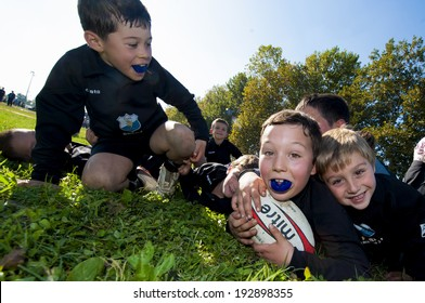 MONZA, ITALY-OCTOBER 25, 2009: young rugby players under 8 of the CUS Torino Rugby team, playing during a mini rugby tournament, in Monza.
