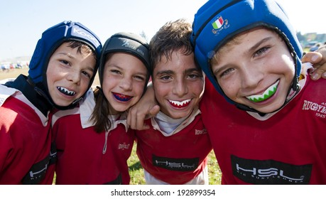 MONZA, ITALY-OCTOBER 25, 2009: young rugby players under 8 of the ASD Rugby Monza team, embracing during a mini rugby tournament, in Monza.
