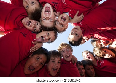 MONZA, ITALY-OCTOBER 25, 2010: children team embrace before to start a mini rugby match, in Monza.