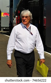 MONZA - SEPTEMBER 11: Bernie Ecclestone checking the paddock at the circuit before starting the formula 1 championship on September 11, 2010 in Monza, Italy