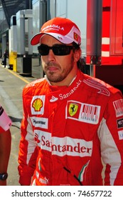 MONZA - SEPTEMBER 11: Fernando Alonso walking from the paddock to the pits on september 11, 2010 in monza, italy, formula 1