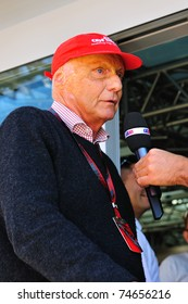 MONZA - SEPTEMBER 11: Formula 1 Driver, Nikki Lauda is talking to the press during the formula one on September 11, 2010 in Monza, Italy