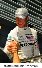 MONZA - SEPTEMBER 11: Michael Schumacher from Germany and Mercedes GP attends press after driving on september 11, 2010 in monza, italy, formula 1