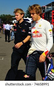 MONZA - SEPTEMBER 11: Sebastian Vettel is walking whit a team member to his car in the pitbox on september 11, 2010 in monza, italy, formula 1