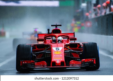 Monza/Italy 08/31/2018  Sebastian Vettel in his scarlet red Ferrari SH71H during the opening practice at the very wet and cold Monza circuit ahead of the 2018 Italian Grand Prix.