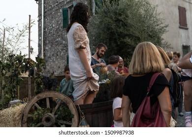 MONZAMBANO, MANTOVA, ITALY, SEPTEMBER, 14, 2019: Monzambano Medieval Re-enactment (Rievocazione Medievale Monzambano), grape stomping