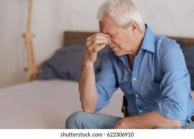Moody aged man feeling unhappy