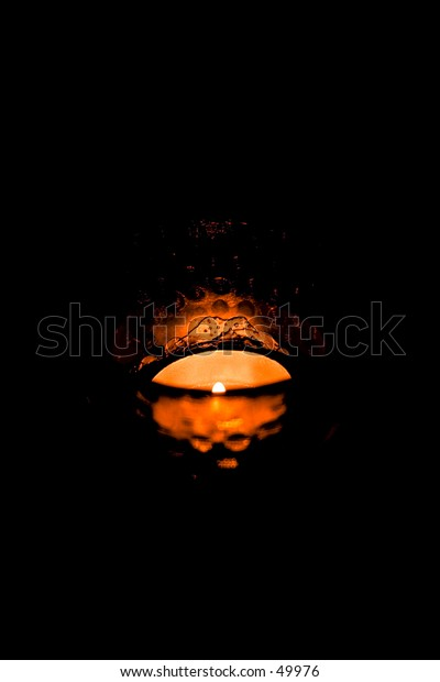 moody candle in black room