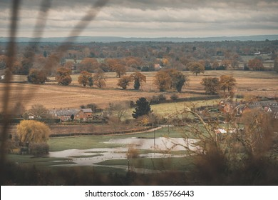 Moody dramatic shot of small farm house surrounded by farmland fall autumn in UK