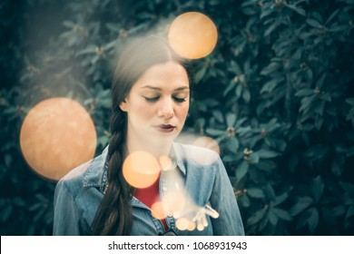Moody and emotional portrait of a beautiful young woman, urban style, with fairy lights - Emotion, thoughts, inner depths concept