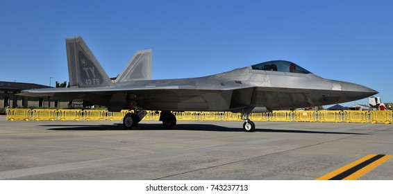 Moody, Georgia, USA - October 27, 2017: An Air Force F-22 Raptor on the runway at Moody Air Force Base. This F-22 belongs to the 325th Fighter Wing.