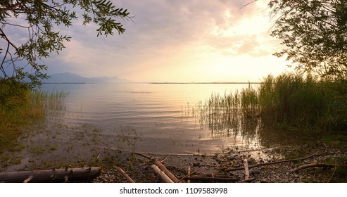 moody landscape upper bavaria - tranquil evening at lake shore chiemsee