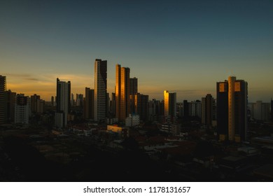 Moody, low key, urban shot of Joao Pessoa, Brazil, depicting it's residential skyscrapers at sunset.