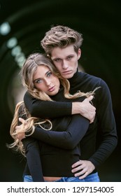 moody model couple in black fashion clothing