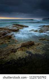 Moody morning with rain and sunshine at Cronulla Beach