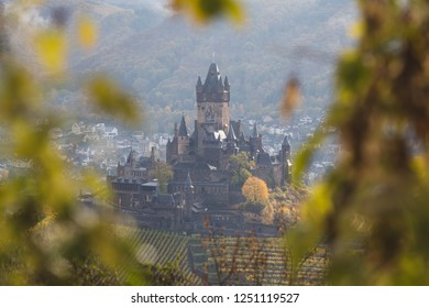 Moody morning shot of the Cochem Castle at the mosel river on a cloudy autumn day, Cochem, Germany