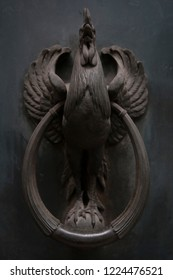A Moody Photograph of a Metal Cockerel Door Knocker