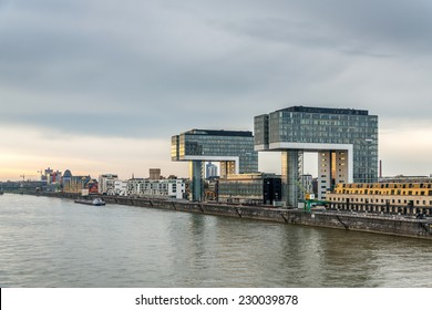A moody riverside image of architecture on the banks of the river rhine in germany