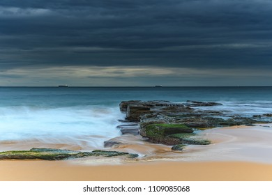 Moody Seascape - Capturing the sunrise from the North End of Forresters Beach on the Central Coast, NSW, Australia.