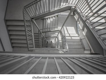 a moody stairwell taken from the top view and done in black and white