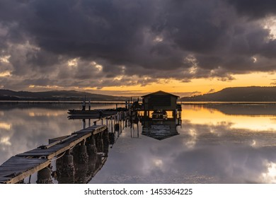 Moody Sunrise with Clouds, Wharf and Oyster Shack - Koolewong Waterfront on the Central Coast, NSW, Australia.