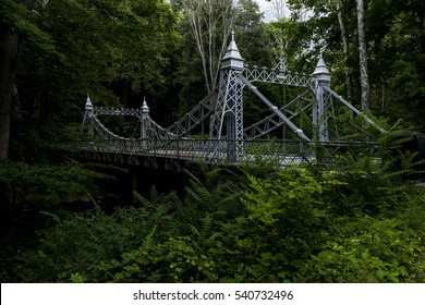 A moody view of a historic suspension bridge at Mill Creek Park in Youngstown, Ohio.