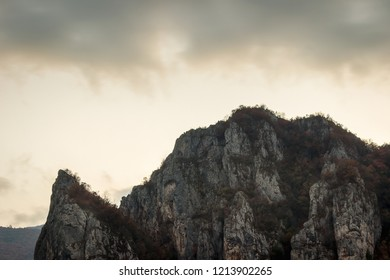 Moody view of iconic mountain over village Vlasi in Serbia, near Pirot, during twilight - Shutterstock ID 1213902265