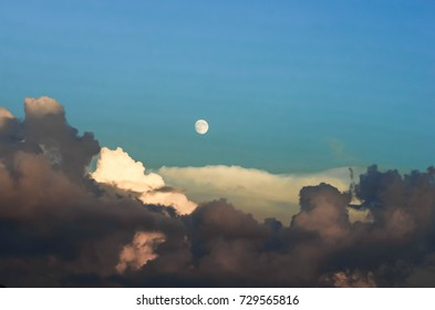 the moon, blue sky and clouds