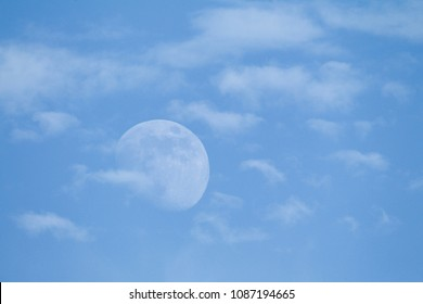 The moon in blue sky with clouds - a real photo that has not been photoshopped